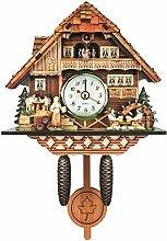 1 horloge à coucou en bois sculpté à piles (K)