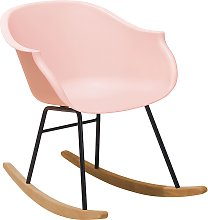 Chaise à bascule rose