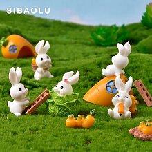 Figurine moderne en résine lapin carotte,