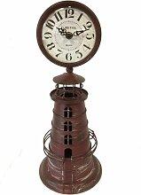 Pendule en métal phare couleur rouille H38cm