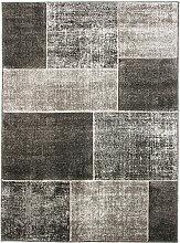 Tapis toucher laineux patchwork de carrés gris