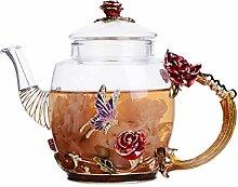 Théière en verre à motif floral avec fleurs en