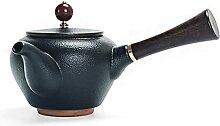 Vintage fait à la main noire poterie côté